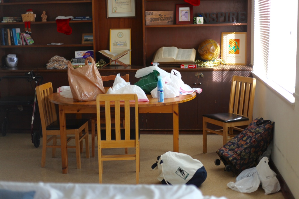 A new residents' belongings at Good Shepherd Center. Intake requires new residents to write down everything in their possession before washing their clothes to ensure cleanliness.