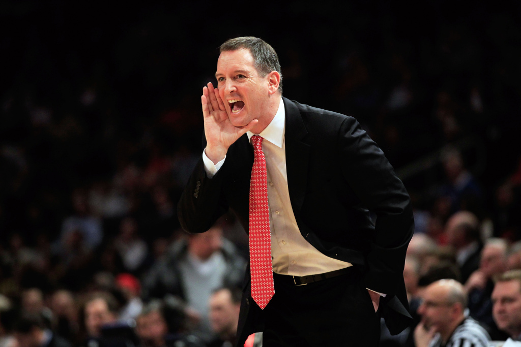Head coach Mike Rice of the Rutgers Scarlet Knights coaches from the sideline against the Villanova Wildcats during their first round game of the 2012 BIG EAST Men's Basketball Tournament at Madison Square Garden on March 6, 2012 in New York City.