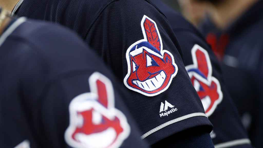 Members of the Cleveland Indians wear uniforms featuring mascot Chief Wahoo as they stand on the field for the national anthem before a baseball game against the Baltimore Orioles in Baltimore in 2017.