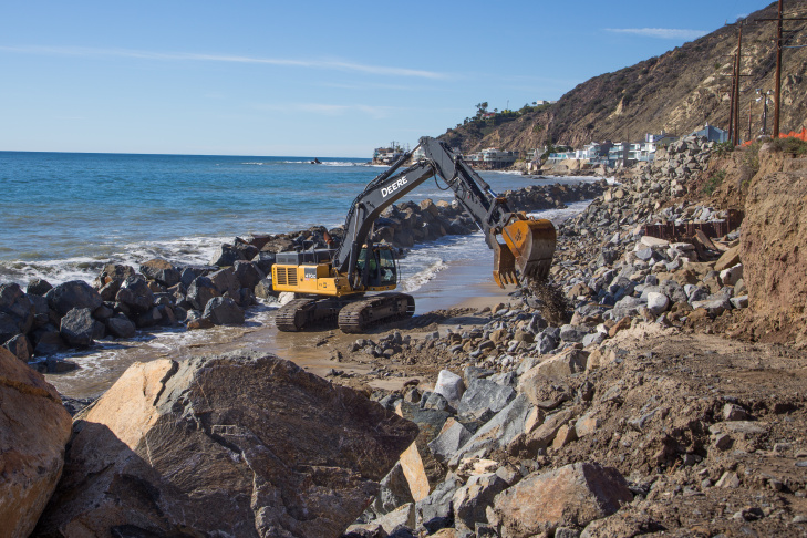 Caltrans crews move boulders to shore up cliffs below the Pacific Coast Highway in Malibu. If the slope is not secured, pounding surf can erode the hillside, causing the highway to eventually wash into the ocean.