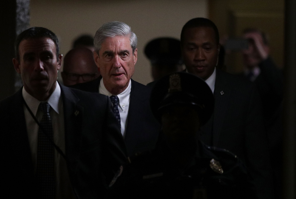 Special counsel Robert Mueller (2nd L) leaves after a closed meeting with members of the Senate Judiciary Committee June 21, 2017 at the Capitol in Washington, DC.