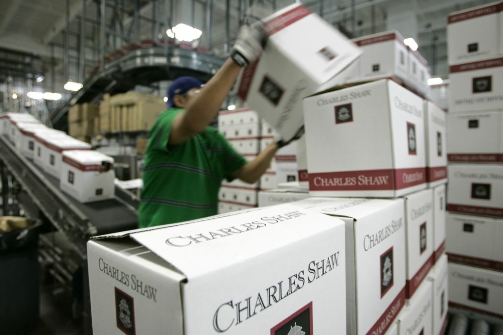 A worker stacks cases of Charles Shaw wine at the Bronco Wine Company facility in Napa, Calif., Tuesday, April 17, 2007. 55,000 cases a day are coming out of this Napa Valley bottling plant, more than some upscale wineries make in a year. And it's owned not by some blue-blooded purveyor of high-end reds but by Fred Franzia, famous for Two Buck Chuck and the ten bucks taboo, as in: No wine is worth more than $10.