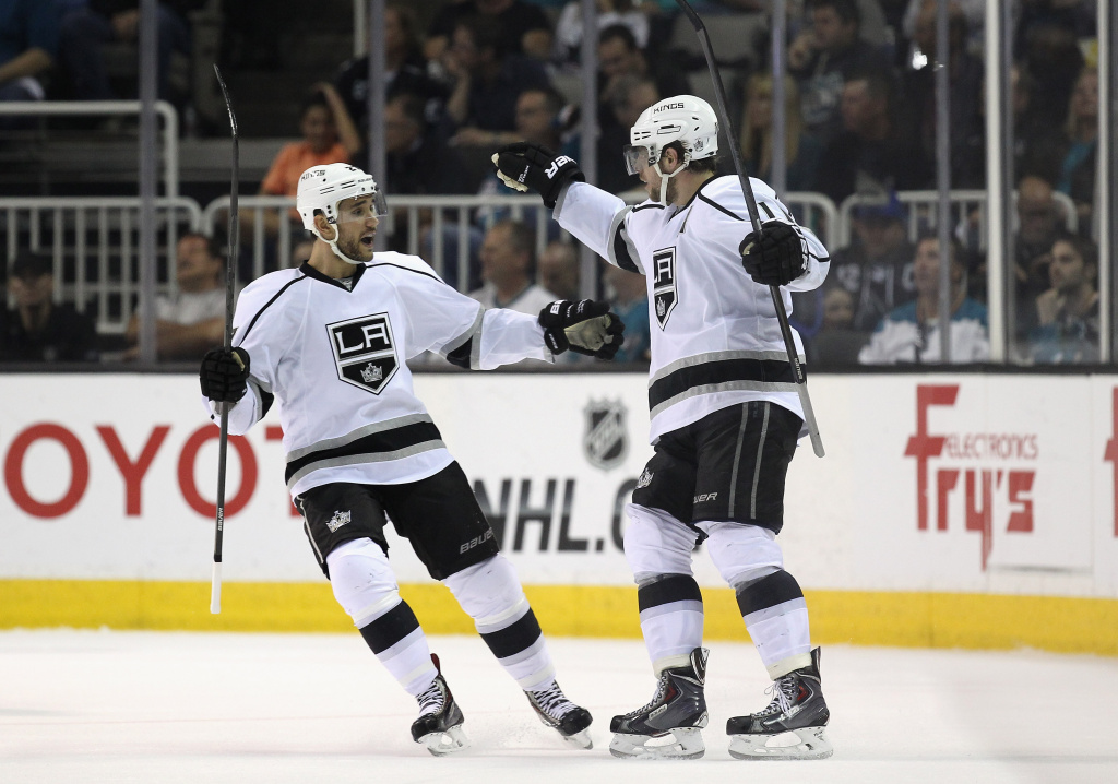 Alec Martinez #27 of the Los Angeles Kings congratulates Anze Kopitar #11 of the Los Angeles Kings after he scored a goal in second period of their game against the San Jose Sharks in Game Seven of the First Round of the 2014 NHL Stanley Cup Playoffs at SAP Center on April 30, 2014 in San Jose, California.