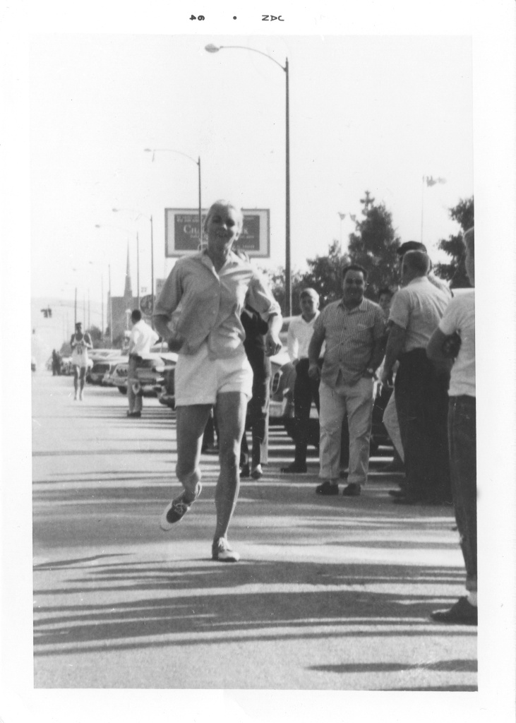 A photo from the San Bernardino Sun newspaper documenting Merry Lepper's finish in the Western Hemisphere Marathon in Culver City in 1963. Merry remembers she didn't feel especially tired after accomplishing the feat, contrary to officials' claims that marathons would damage women's