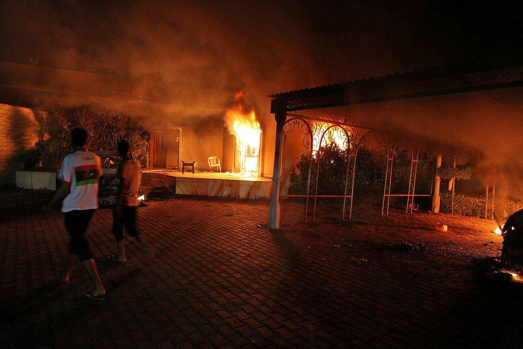 A vehicle (R) and the surround buildings burn after they were set on fire inside the US consulate compound in Benghazi late on September 11, 2012. An armed mob protesting over a film they said offended Islam, attacked the US consulate in Benghazi and set fire to the building, killing one American, witnesses and officials said.