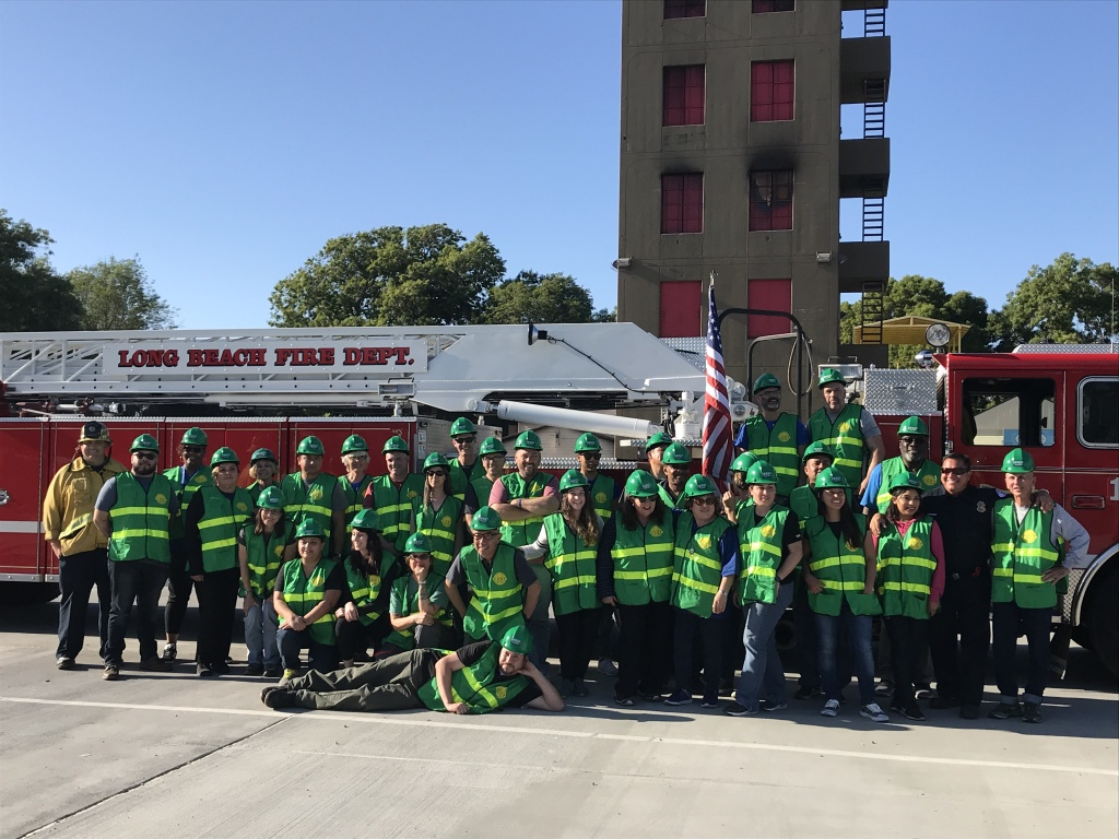 The entire group of 32 CERT trainees and program manager Jake Heflin in his firefighting uniform on the far left. More than 1,000 people have graduated from CERT programs in Long Beach since they started.