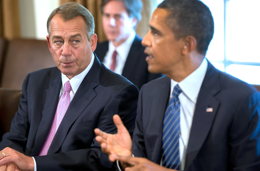 Speaker of the House John Boehner (L), R-OH listens as US President Barack Obama delivers a statement on Syria during a meeting with members of Congress at the White House in Washington, DC, September 3, 2013.