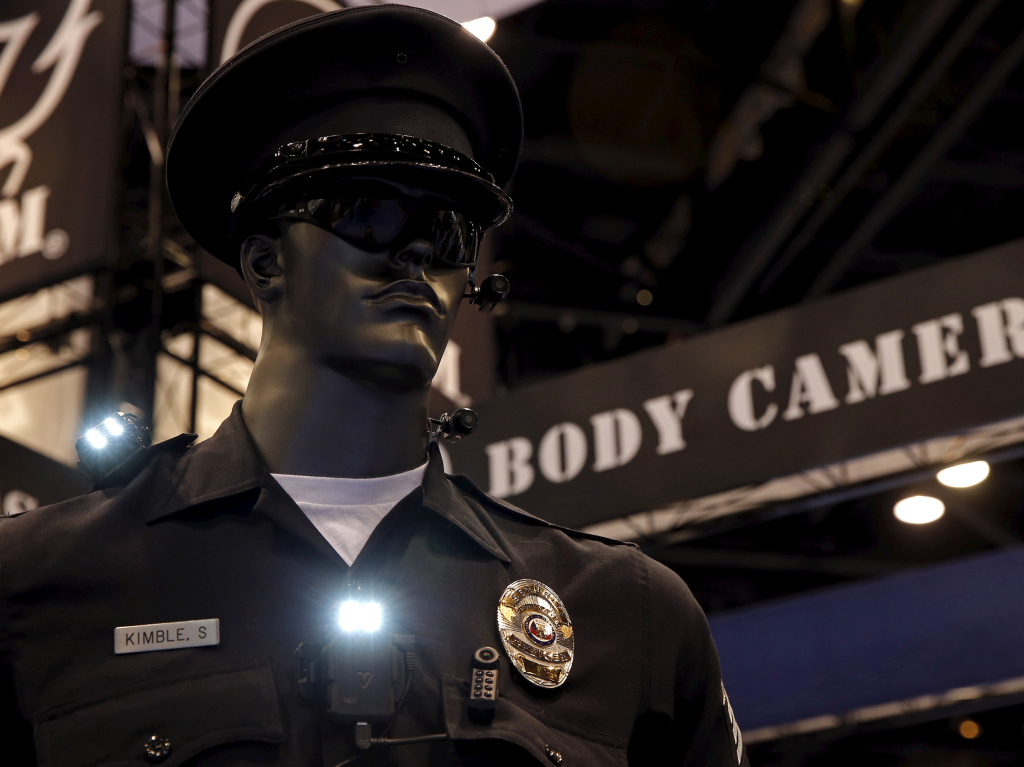 File: Police body cameras are seen on a mannequin at an exhibit booth by manufacturer Wolfcom at the International Association of Chiefs of Police conference in Chicago.
