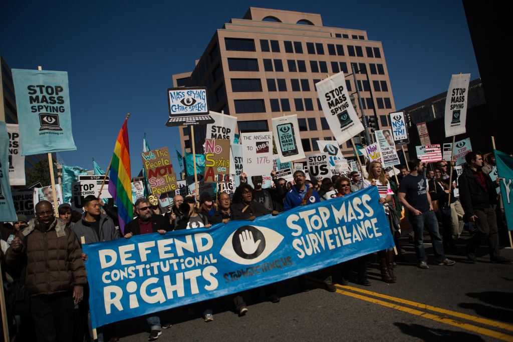 Protesters march through downtown Washington D.C. during the Stop Watching Us Rally protesting surveillance by the U.S. National Security Agency, on Oct. 26, 2013, in front of the U.S. Capitol building in Washington, D.C.