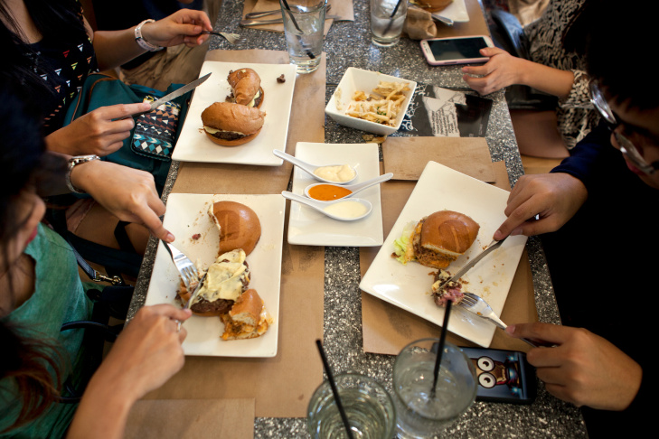 Eunice Tan has lunch with friends on Friday, Oct. 18 at Umami Burger's flagship location at the Grove. The restaurant first opened in Los Angeles in 2009 and now has 22 locations including Miami Beach and New York City.