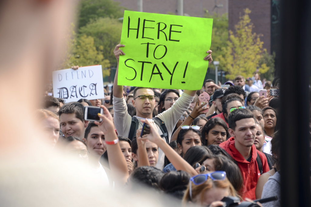 FILE: Demonstrators on the campus of Metropolitan State University in Denver protest President Trump's decision to end the DACA program.