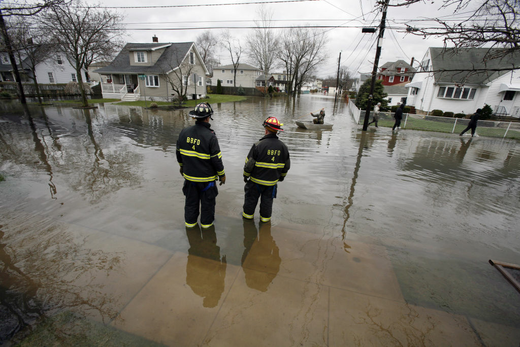 Rescue workers come to the aid of residents trapped by rising flood waters April 16, 2007 in Bound Brook, New Jersey. A Nor'easter storm brought record rains and floods to the East Coast.