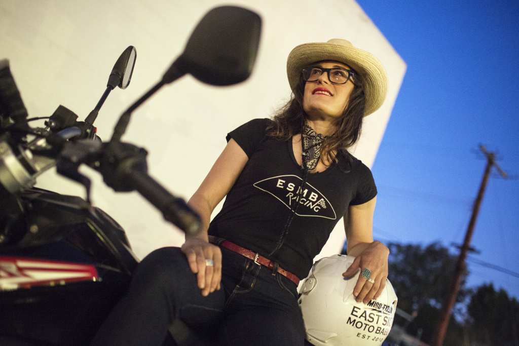 Stacie B. London is the president and founder of the Eastside Moto Babes. London prepares to ride a 2014 Husqvarna Strada 650 during the group's weekly Tuesday night ride on August 2, 2016 from the Tomato Pie Pizza Joint parking lot in Silverlake.