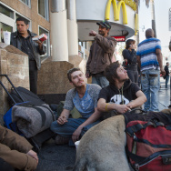 File: A group of homeless travelers eat food that they purchased with McDonald's gift cards that they received after completing the Homeless Count survey.