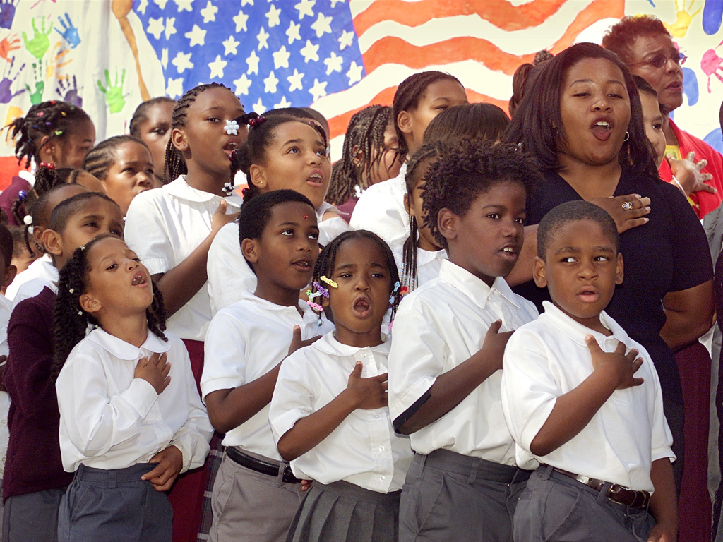 Students from Amido Elementary School give the Pledge of Allegiance 12 October 2001 in Washington, DC.