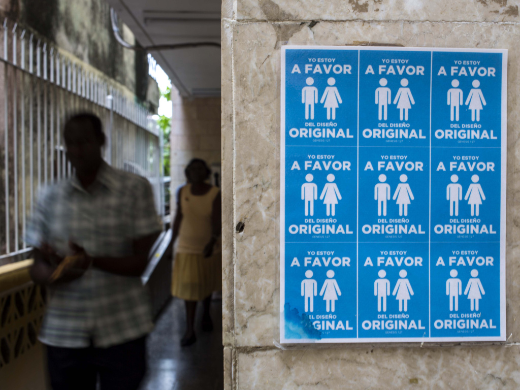 The Cuban government announced plans to remove wording that would open the island to same-sex marriage from the latest draft of its new constitution. In October, Cubans who protested the controversial amendment hung posters saying,