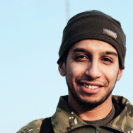 This undated image made available in the Islamic State's English-language magazine Dabiq, shows Belgian Abdelhamid Abaaoud.  Abaaoud the Belgian jihadi suspected of masterminding deadly attacks in Paris was killed in a police raid on a suburban apartment building, the city prosecutor's office announced Thursday Nov. 1, 2015. Paris Prosecutor Francois Molins' office said 27-year-old Abdelhamid Abaaoud was identified based on skin samples. His body was found in the apartment building targeted in the chaotic and bloody raid in the Paris suburb of Saint-Denis on Wednesday. (Militant photo via AP)