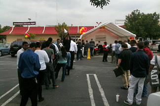 Dozens of job seekers line up in parking lot of McDonald's on La Cienega Blvd. near Baldwin Hills.