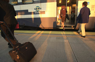 Passengers board a Metrolink train for the Los Angeles-bound morning commute.