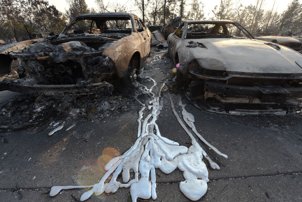Melted metal from burnt cars is formed on the ground after wildfires ripped through the Coffey Park neighborhood of Santa Rosa, California on October 11, 2017.