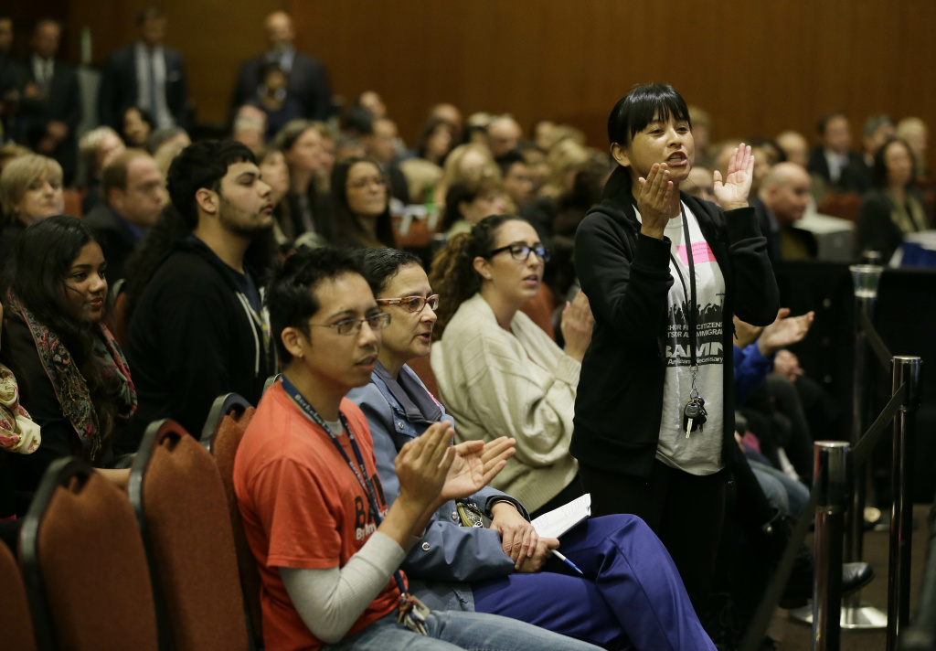 Yvette Felarca, an alumni of the University of California Berkeley and member of the group By Any Means Necessary, claps and yells as a vote is taken to raise tuition during a meeting of the University of California Board of Regents Wednesday, Nov. 19, 2014, in San Francisco. A committee of the Regents approved UC President Janet Napolitano's proposal to raise tuition as much as 5 percent annually. (AP Photo/Eric Risberg)