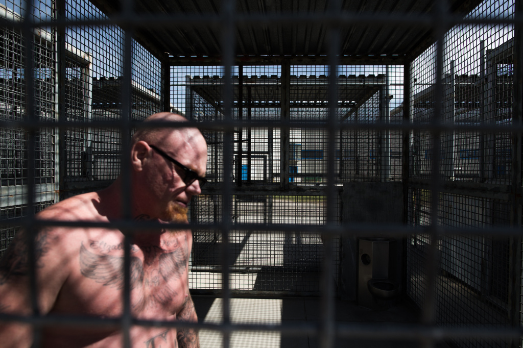 An inmate walks laps in his exercise cage at one of Corcoran's Security Housing Units.