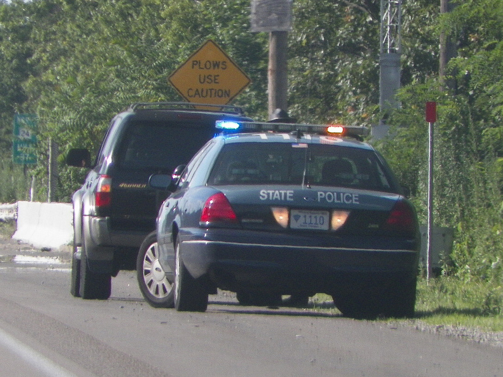 In this unrelated photo, a Massachusetts State Police car stops a driver on a road in Raynham, Mass.