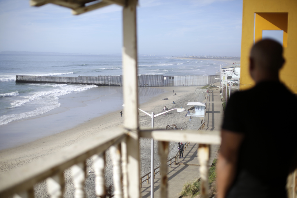 U.S. Marine veteran Antonio Romo, who was deported, looks out from his apartment balcony in Tijuana, Mexico, where he can see the U.S. border wall separating San Diego from Tijuana, Mexico. Romo, who became a U.S. resident before enlisting, was sent to federal prison in Texas for conspiracy to distribute and sell cocaine. He said prison made him human again because it was there that he first got psychological help.