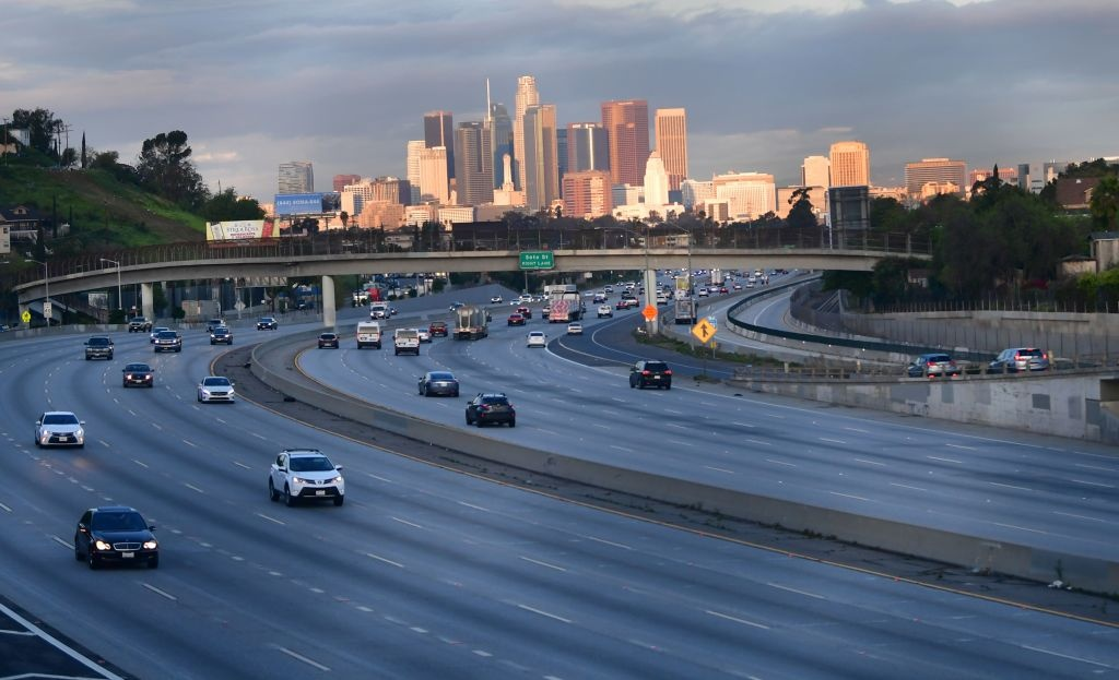 The normally busy morning freway commute see's less cars on the roads of Los Angeles, California on March 20, 2020, a day after Los Angeles County announced a near-lockdown, urging all residents to stay home except for essential needs.