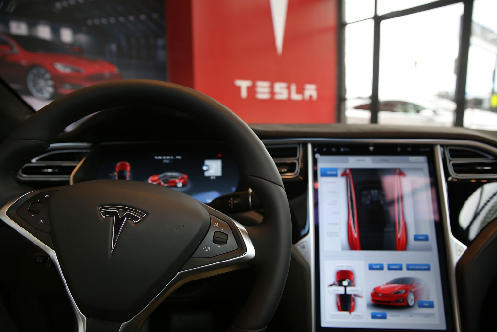 The inside of a Tesla vehicle is viewed as it sits parked in a new Tesla showroom and service center. The electric car company and its CEO and founder Elon Musk have come under scrutiny following a crash of one of its electric cars while using the controversial autopilot service.