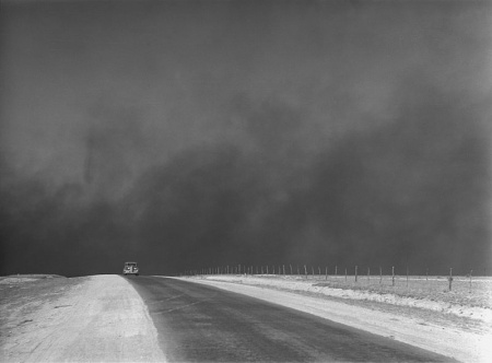 "A car is chased by a ""black blizzard"" in the Texas Panhandle, March 1936."