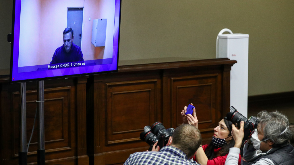 Journalists watch Alexei Navalny appear on a video screen in a Moscow regional court. The court rejected Navalny's appeal of his 30-day detention.