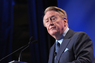 Vin Scully announced that he will continue to call Dodgers' games in the 2011 season. In this photo, Scully speaks at the Hollywood Radio & Television Society Newsmaker Lunheon at the Beverly Wilshire Hotel on Nov. 10, 2009 in Beverly Hills, California.