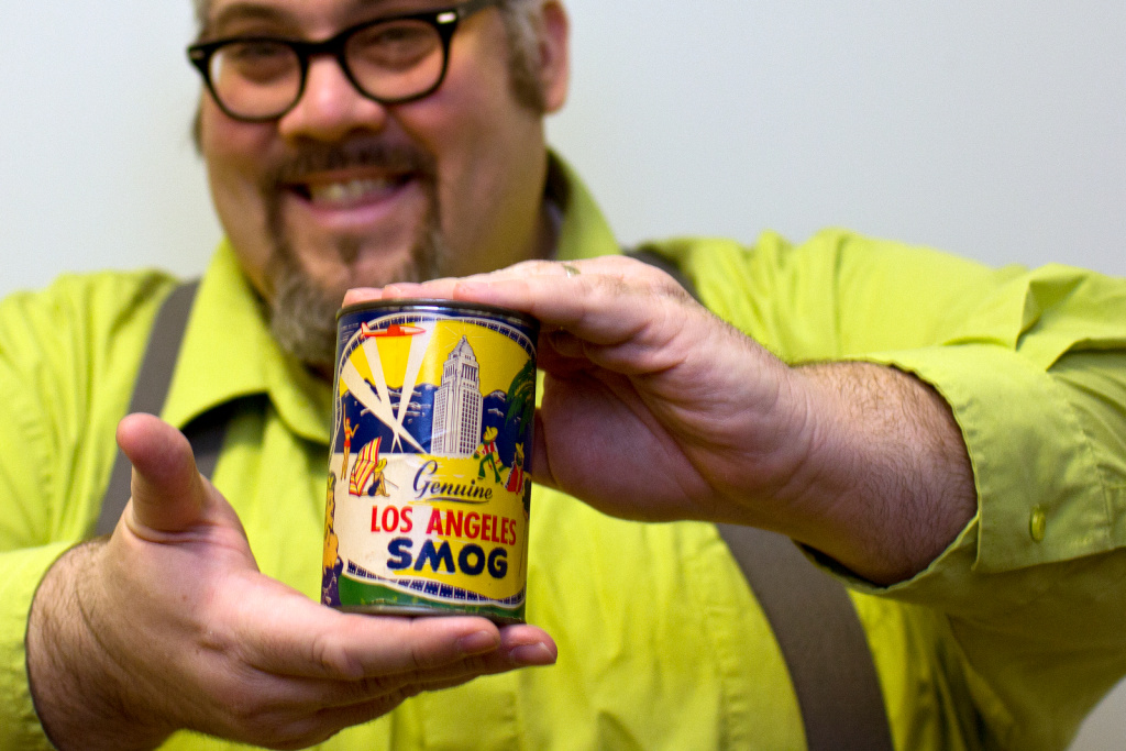 Chris Nichols holds a can of LA smog, which he has yet to open.