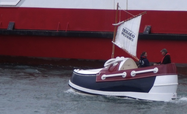 Cowes Week is an enormous regatta on the Isle of Wight. A deck shoe boat is an enormous deck shoe.