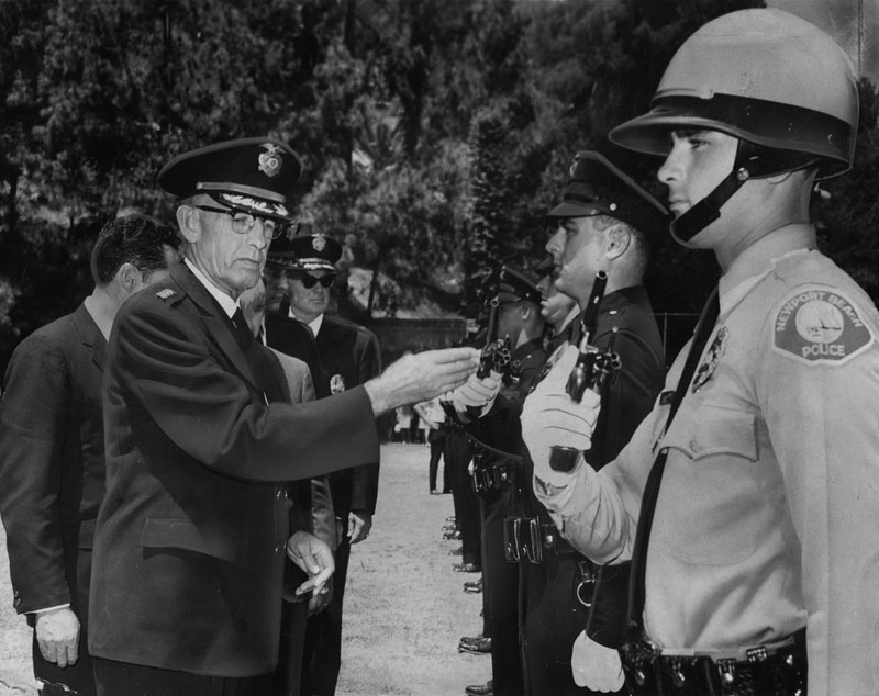 Los Angeles Police Chief William H. Parker was active to the last. He is pictured on July 15, 1966, the day before his death, inspecting a Police Academy graduating class. The class consisted of 100 new officers for the Los Angeles Police Department and nearby cities.