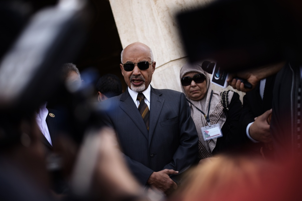 Mohamed al-Megaryef (C), president of Libya's highest political authority the General National Congress, reacts as he talks to the press after laying a wreath of flowers at the US Ambassador residence on September 14, 2012 in Benghazi, Libya.