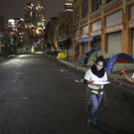 Volunteers count homeless people on a dark street on Skid Row during the 2015 Greater Los Angeles Homeless Count conducted by the Los Angeles Homeless Services Authority (LAHSA).