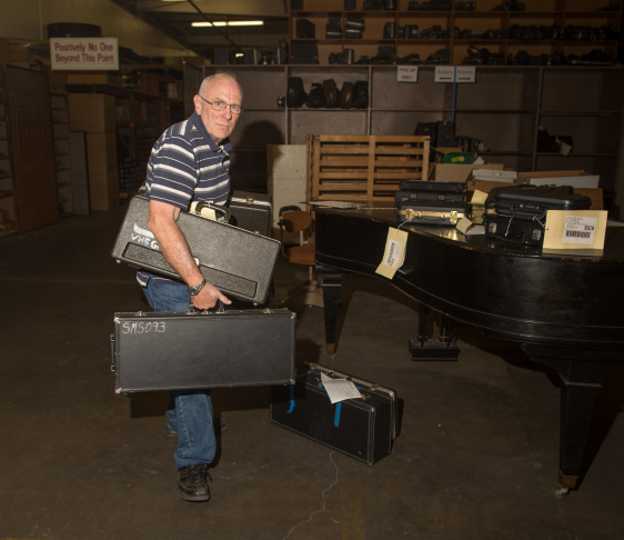 Steve Bagmanyan, a piano repair technician tunes a Steinway and Sons piano at the LAUSD Music Repair Shop.