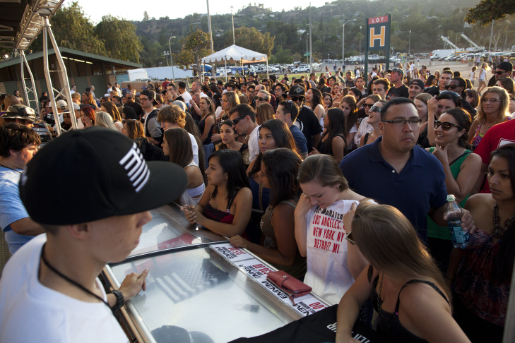 People head into the Rose Bowl for the Eminem and Rihanna concert. The stadium is hosting more concerts to pay down debt from renovations, but the increased traffic can burden residents.