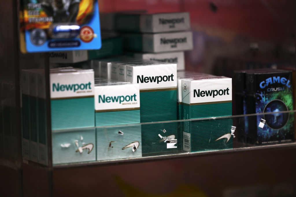 Packs of Newport cigarettes are seen on a shelf in a grocery store in the Flatbush neighborhood on April 29, 2021 in the Brooklyn borough of New York City.