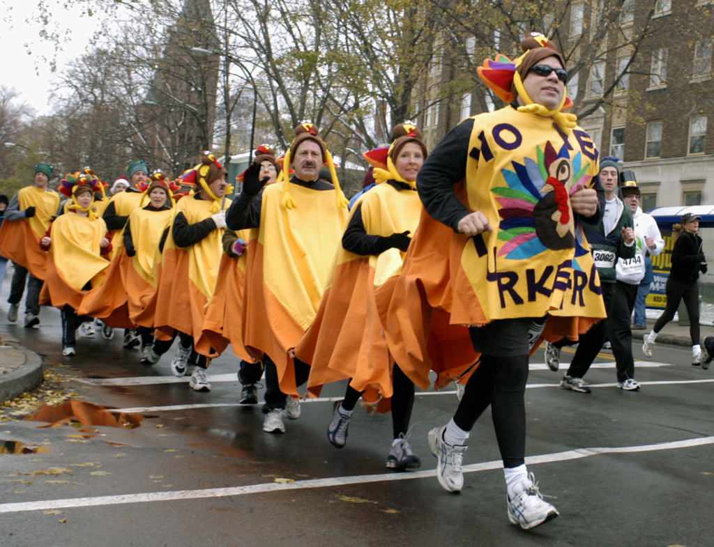 In this file photo, costumed participants run along Delaware Avenue in the 110th annual Turkey Trot in Buffalo, N.Y, Thursday, Nov. 24, 2005. Over 6,000 runners were registered for the oldest foot-race in United States recorded history. The newest spot to participate locally will be in Downtown L.A., one of at least 20 running and walking events on Thursday's Southern California race calendar.