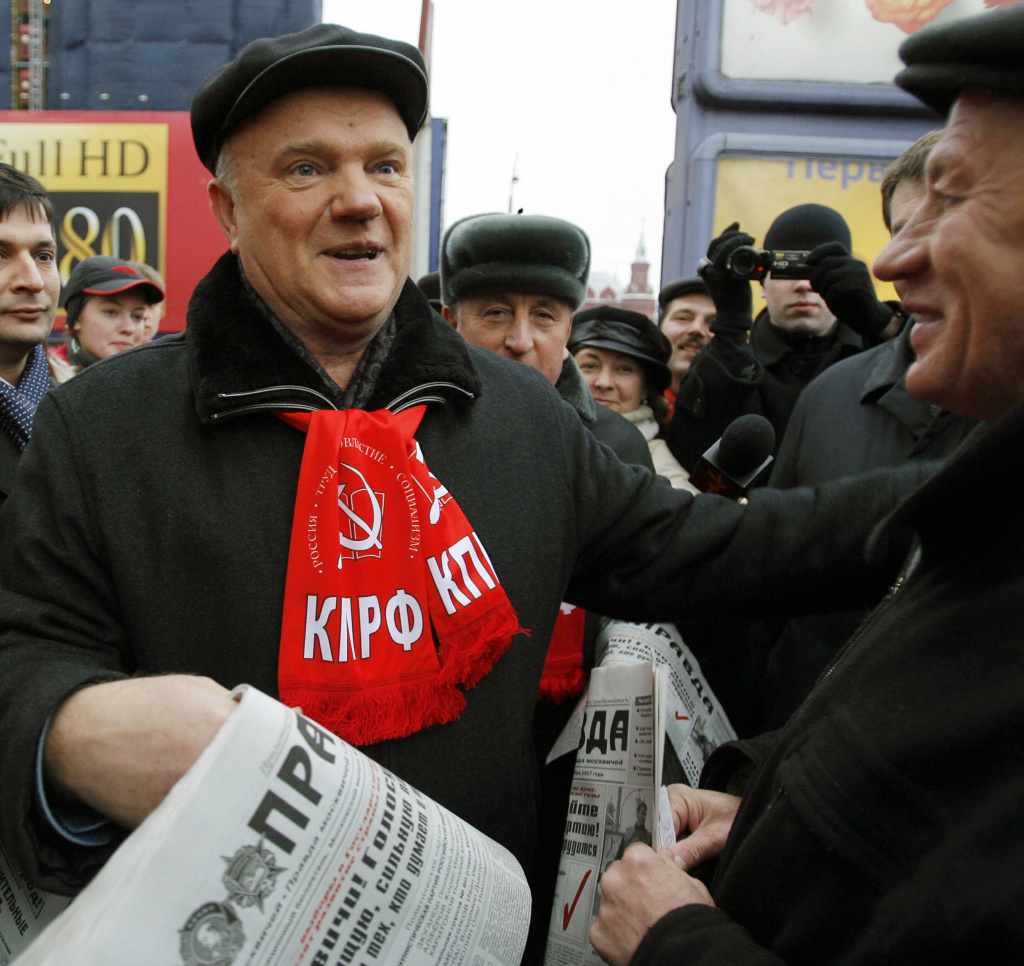 The leader of Russian Communists, Gennady Zyuganov (left), hands out his party's