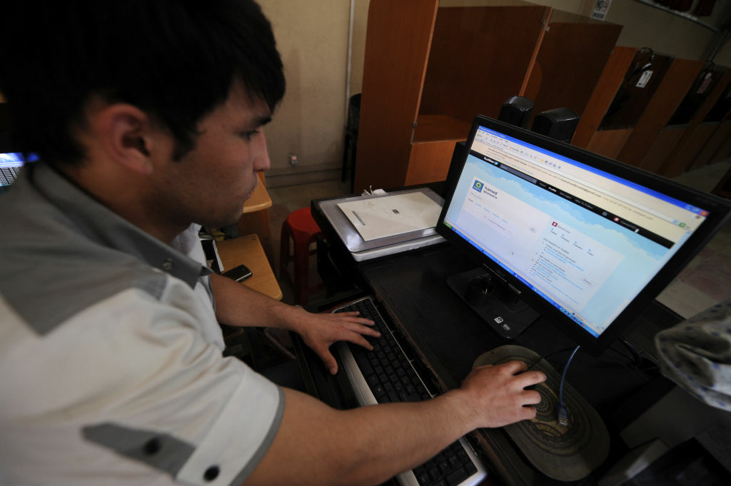 An Afghan resident uses a computer to access 'Twitter' website in Kabul on May 15, 2011.