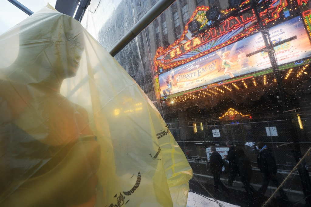 An Oscar statue covered in plastic is seen on the red carpet as preparations continue for the 86th Annual Academy Awards, March 1, 2014, in Hollywood, California. The red carpet is covered by a plastic tarp in anticipation of more heavy rains before the 86th Academy Awards show on March 2.