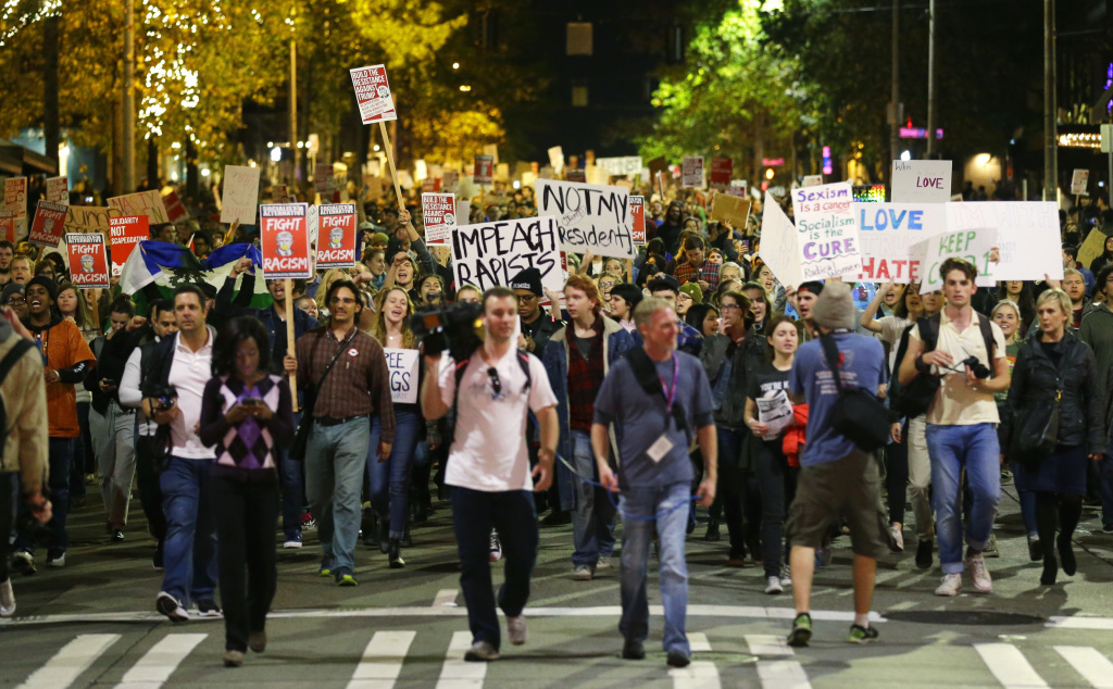 Hundreds of protesters march in downtown Seattle as they protest the election of President-elect Donald Trump, Wednesday, Nov. 9, 2016. A day after Trump's election as president, the divisions he exposed only showed signs of widening as many thousands of protesters flooded streets across the country to condemn him. (AP Photo/Ted S. Warren)
