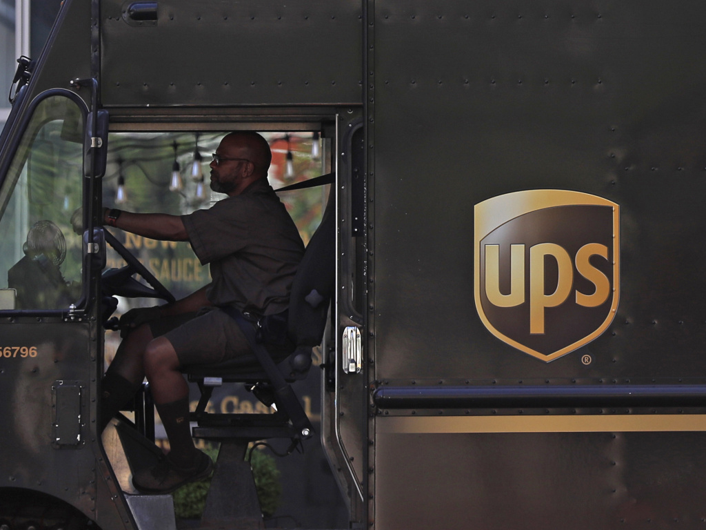A UPS driver stops at a traffic light on April 24 in St. Louis. UPS employees are now allowed to grow their beards as the company loosens up on its appearance rules.
