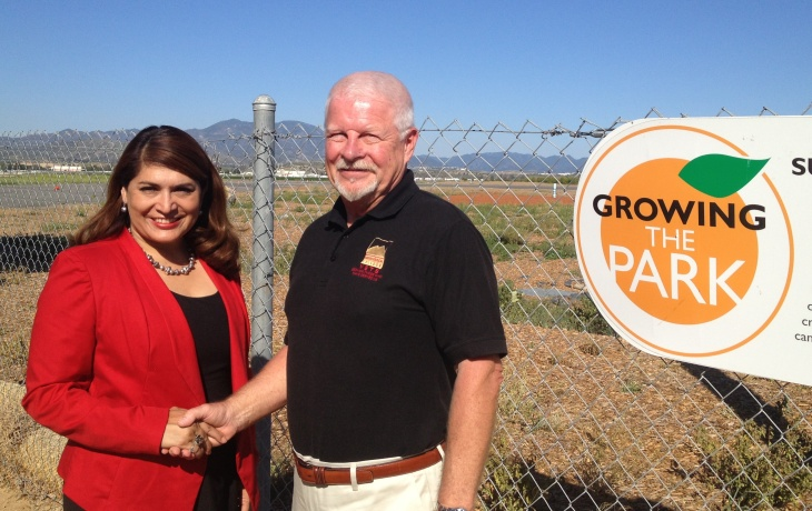 Assemblywoman Sharon Quirk-Silva (L) has introduced legislation to establish a veterans cemetery in Orange County. Bill Cook (R) wants that cemetery to be located in the Great Park (background), which was the El Toro Marine Air Base when he flew from there to Vietnam in 1968.