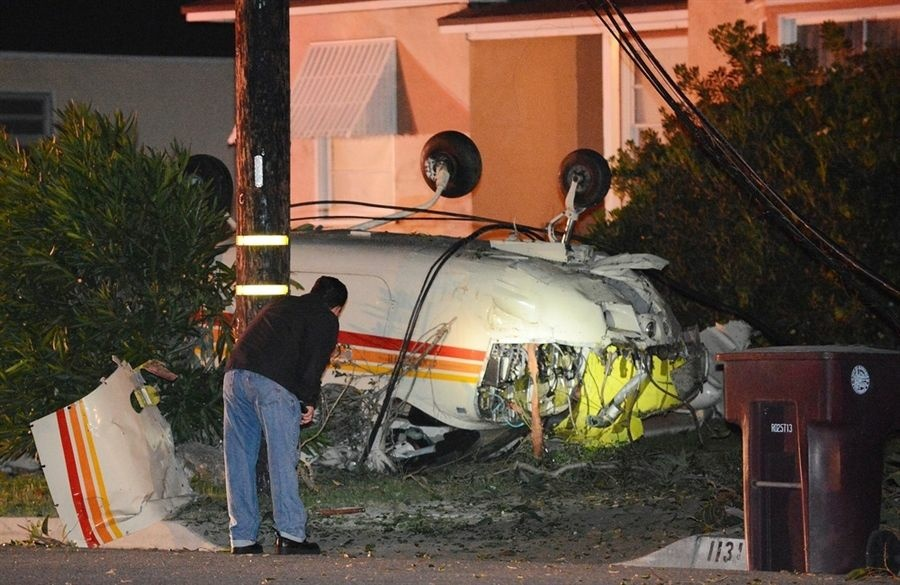 The wreck of a crashed Cessna 210 is seen in front of a home in Glendale on Monday, May 21, 2012.