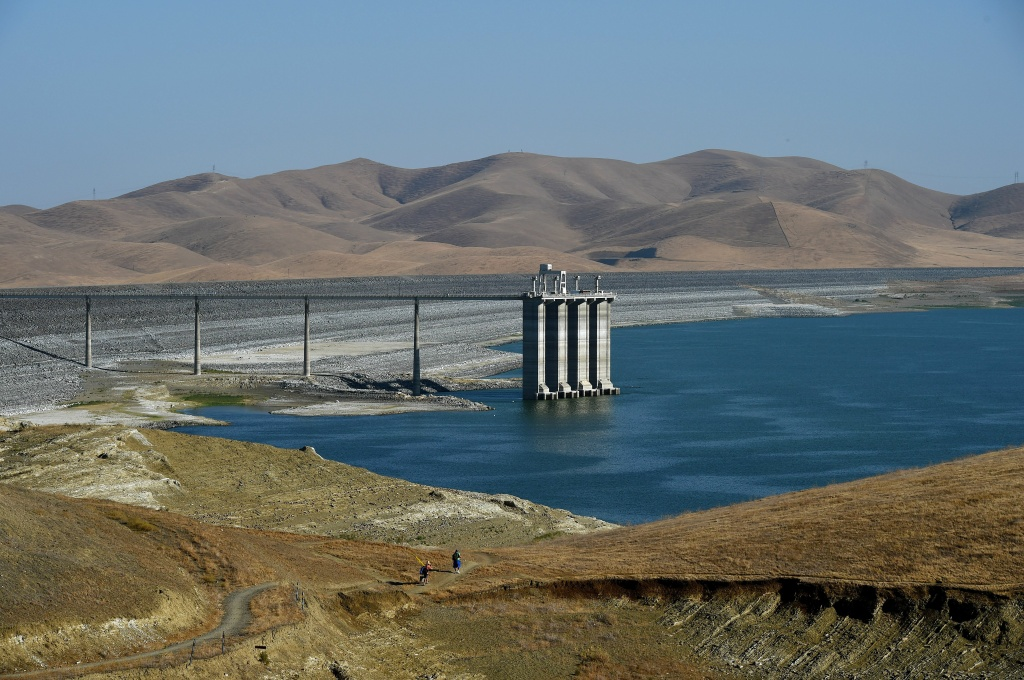 This file photo shows the exposed dam wall and water intakes of the San Luis reservoir in September 2014. The State Water Resources Control Board is expected Tuesday to reveal how much water cities conserved in October 2015.